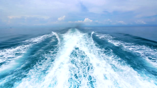 Boat wake on the blue ocean sea​ video