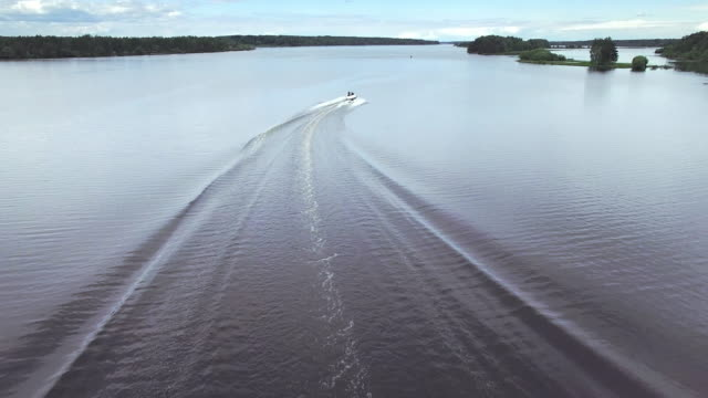Boating on river - aerial view video