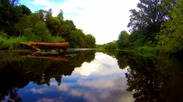 Boating on wide river, wooden debris after storm, hurricane video