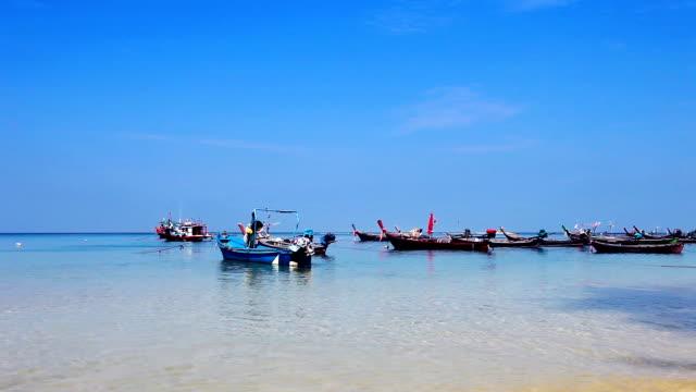 Boats in the tropical sea near beach