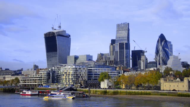 boats on thames river and london skyline, wide angle cityscape lit by the sun on a bright autumn afternoon. - post modern architecture stock videos & royalty-free footage