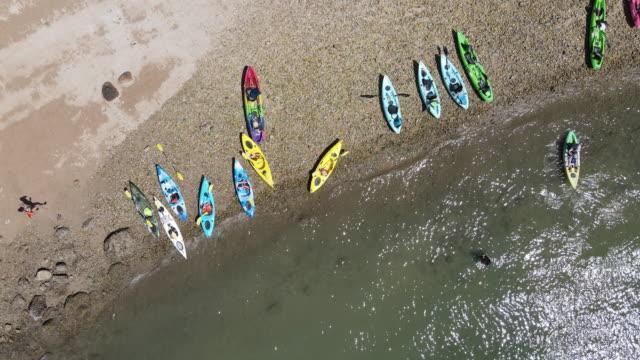 boats on the beautiful beach of sai kung, hong kong - vivid 4k video stock videos & royalty-free footage