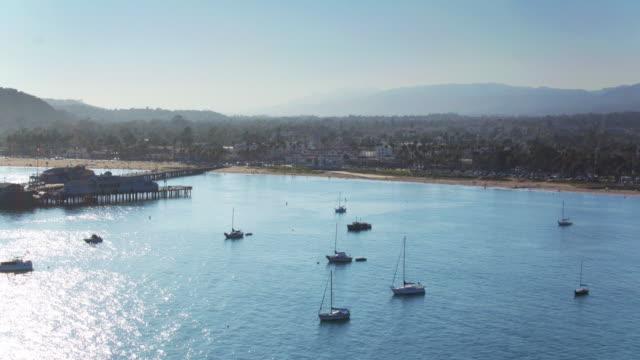 Boats on the Sea by Santa Barbara, California - Drone Shot Flying Inland video