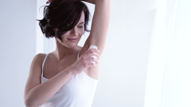 Body Care. Woman Using Ball Deodorant For Armpit Skin video