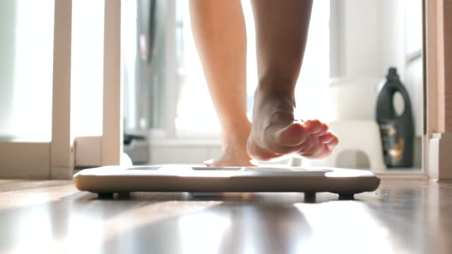 Body Weight scale Nutrient, Mass - Unit of Measurement standing stock videos & royalty-free footage