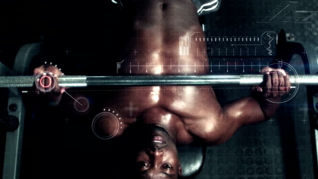 Bodybuilder lifting heavy barbell weights against animated background video