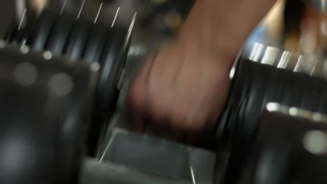 Bodybuilder takes the dumbbell. video