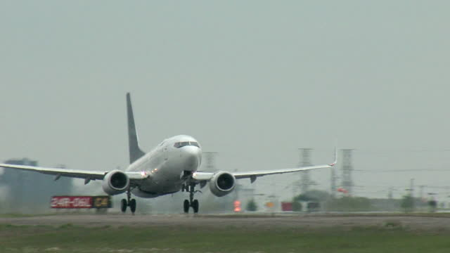 Boeing 737 Airplane Taking Off A Boeing 737 take off from the runway airport runway stock videos & royalty-free footage