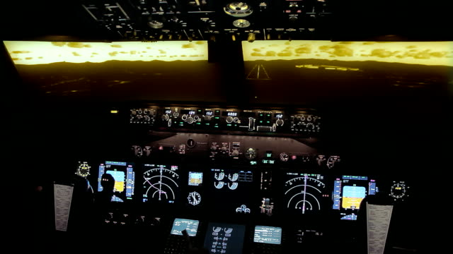 Boeing 737 NG cockpit evening approach - Flight Simulator Landing from cockpit in a Boeing 737 professional flight simulator.  cockpit stock videos & royalty-free footage