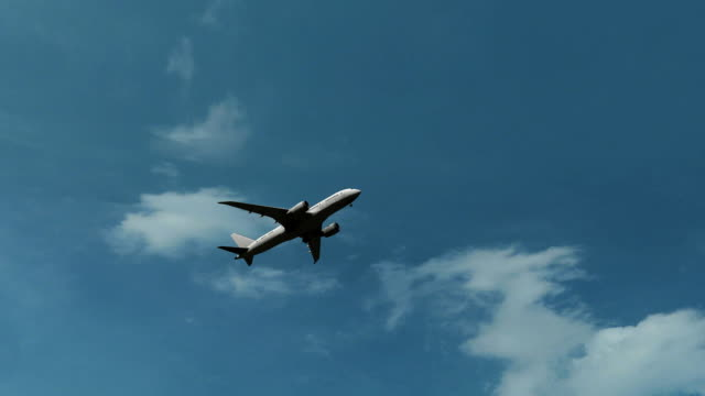 Boeing 787 airliner climbing against beautiful sunny cloudy sky, no logo, FullHD video