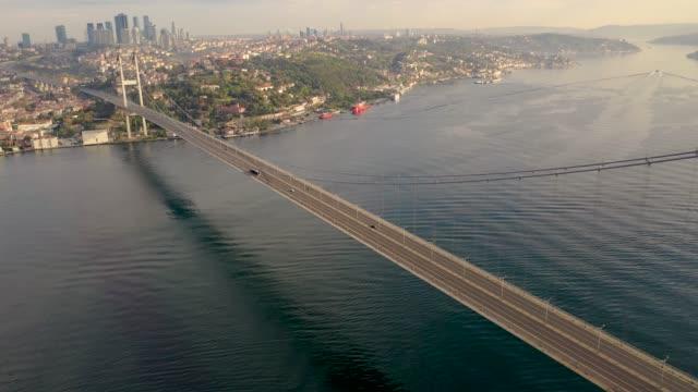bogazici bridge also known as 15 july martyrs bridge from istanbul turkiye aerial view with drone. - męczennik filmów i materiałów b-roll