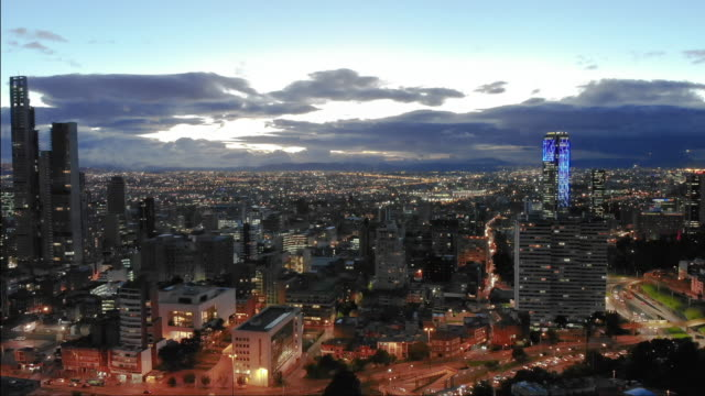 bogota evening from a drone point of view - колумбия стоковые видео и кадры b-roll