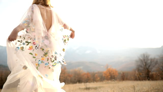 Bohemian dance Young boho girl dancing in the meadow,spinning around in white floral dress dress stock videos & royalty-free footage