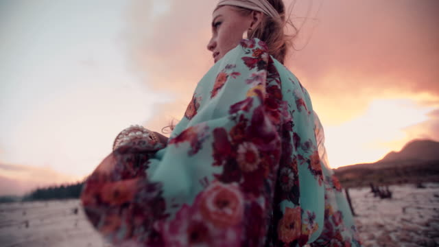 Boho girl dancing in floral dress on a summer evening video