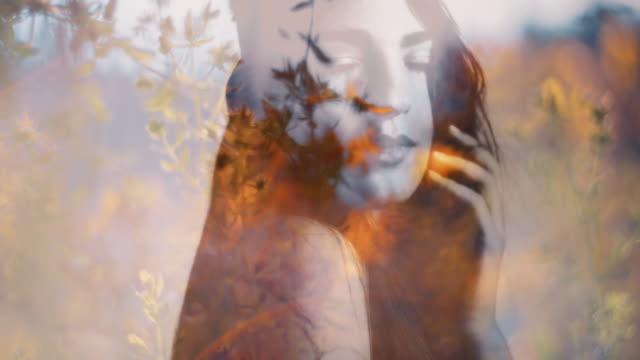 Boho girl double exposure with wild flowers video