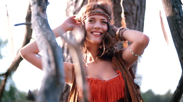 Boho girl in tribal fashion dancing in afternoon sunlight video