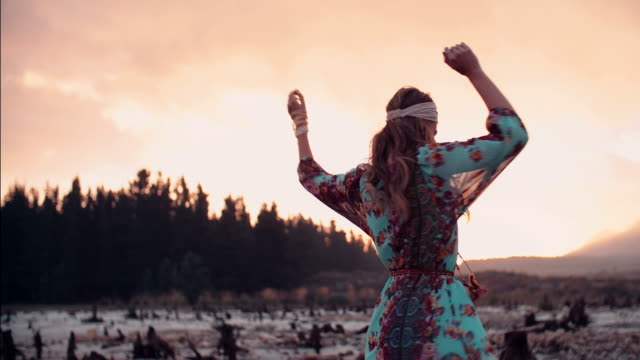 Boho girl spinning at sunset for freedom video