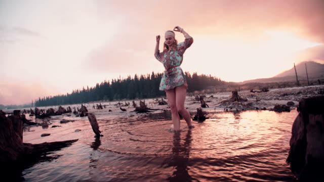 Boho girl spinning at sunset for freedom video