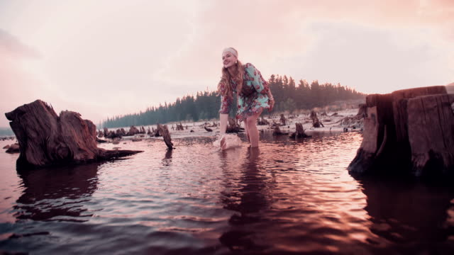 Boho girl splashing water in slow motion video