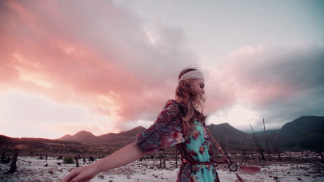 Boho girl walking in nature on a summer evening video