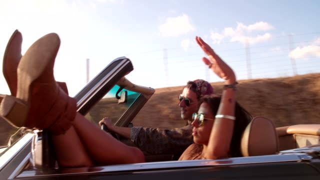 Boho style teenage girl lovers enjoys a summer  road trip video