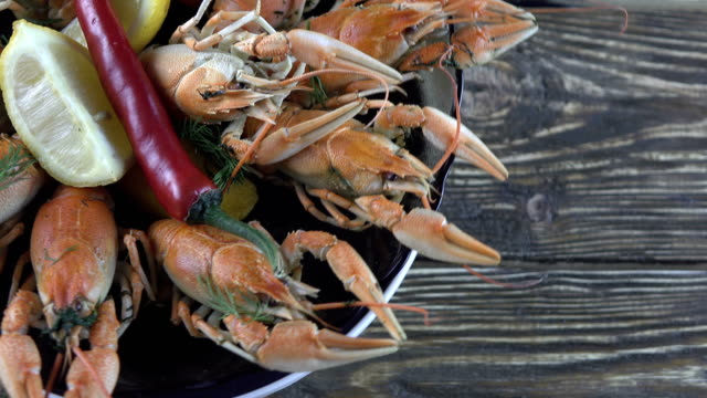 Boiled crayfish on wooden background Boiled crayfish on wooden background tray stock videos & royalty-free footage