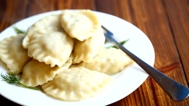 Boiled dumplings stuffed Boiled dumplings stuffed on a wooden table ravioli stock videos & royalty-free footage