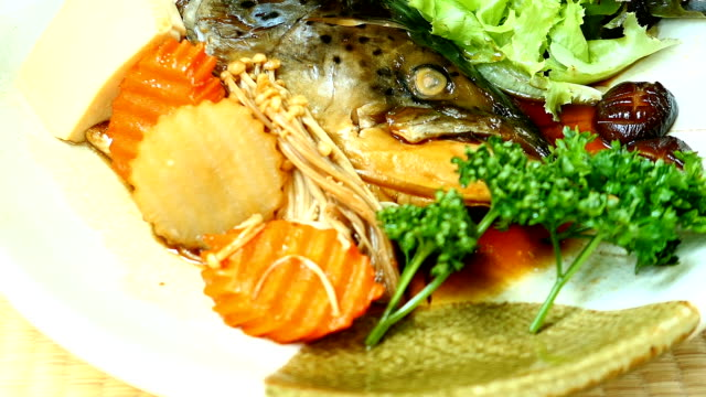 Boiled Head of salmon fish with sweet sauce and vegetable video