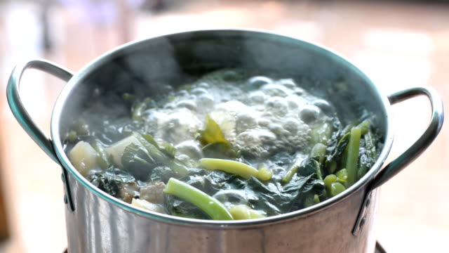 boiled vegettables in the pot Cliose-up of boiled vegettables in the pot boiled stock videos & royalty-free footage
