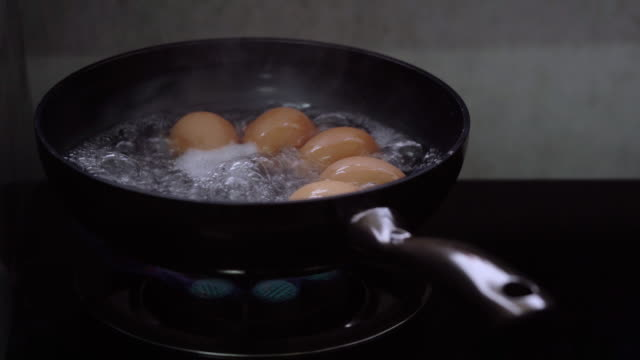 Boiling chicken eggs in a pan Boiling chicken eggs in a pan boiled stock videos & royalty-free footage