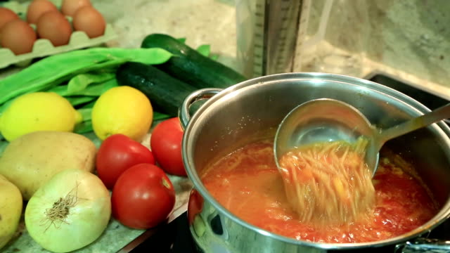 Boiling pot of vegetable soup video