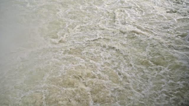 boiling stream of dam water discharge - молдавия стоковые видео и кадры b-roll