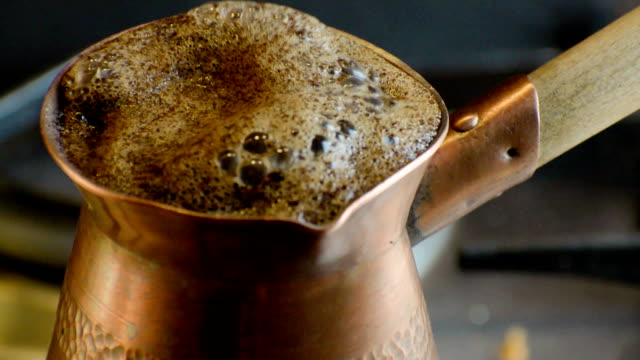 Boiling turkish coffee in copper cezve. video