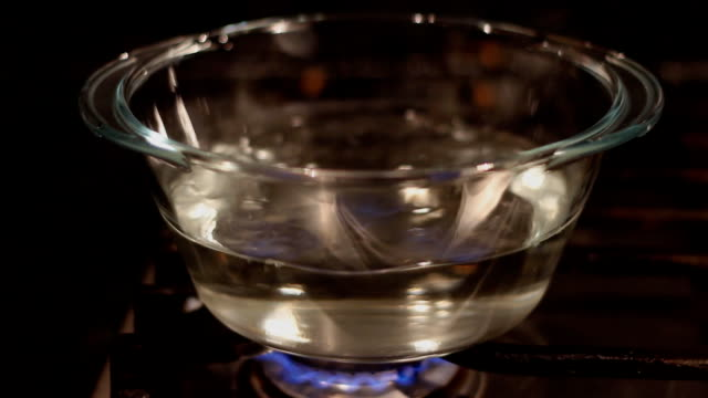 boiling water in transparent glass pot video