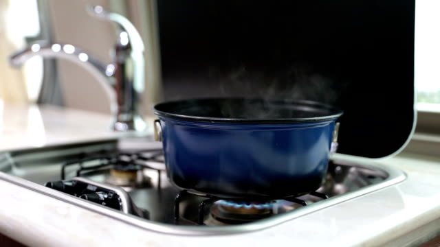 Boiling Water or Food Inside Campervan HD video of Boiling Water or Food Inside Campervan on stove rv interior stock videos & royalty-free footage