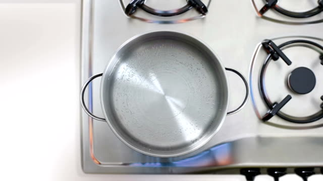 Boiling water Boiling water on gas flame iniron pan cooking pan stock videos & royalty-free footage