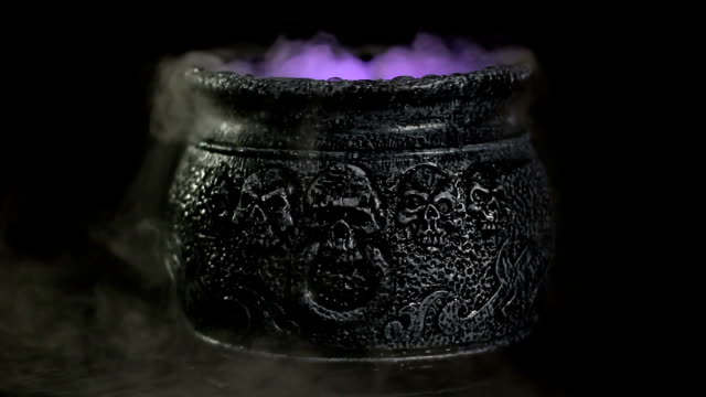 Boiling Witches Cauldron with mist / steam Stock HD video clip footage of a Witches cauldron bubbling with steam / mist boiled stock videos & royalty-free footage