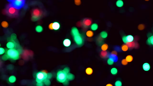 Bokeh Christmas lights flashing is colourful.