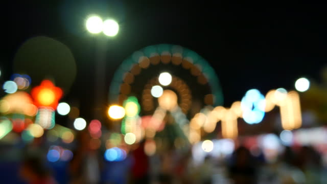 Bokeh circle light blurred time-lapse at night time in the amusement park , Time-lapse movement video