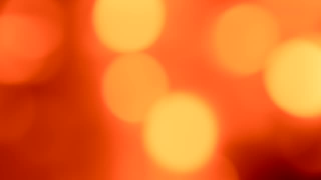 bokeh glow background red orange circles motion Bokeh glow background. Blur gleam. Defocused red orange glaring circles motion. sequin stock videos & royalty-free footage