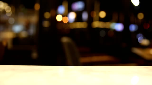 Bokeh in bar at night background video