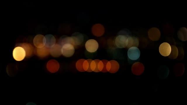 Bokeh in dark blurry background at night, Defocused night traffic lights, Glassy circular shapes