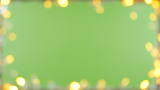 vídeos de stock e filmes b-roll de bokeh light frame green screen background - feriado