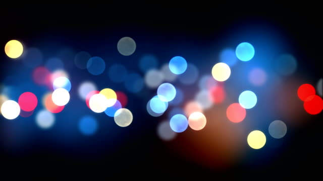 Bokeh Seamless Background Animation on Black. Colorful Blurred Bright Blinking Lights.