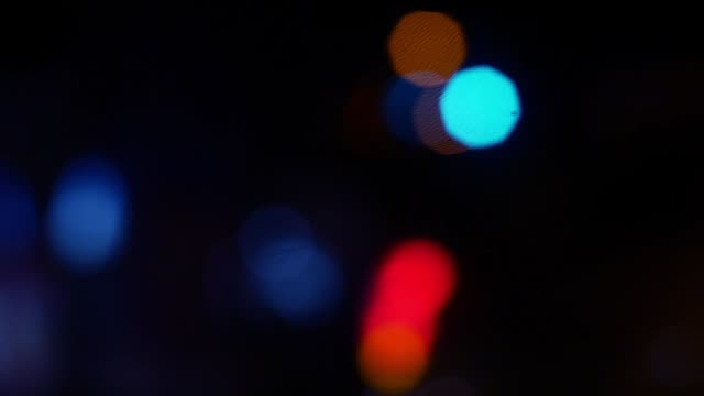 bokeh street road at night shooting inside from car driver view. video