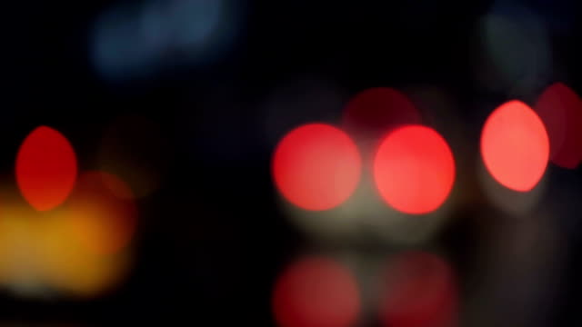 Bokeh traffic lights in the night video