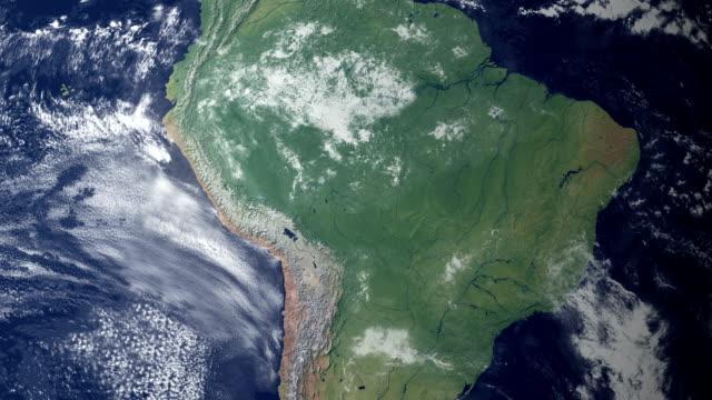 bolivia pops up after earth zoom  (with alpha matte) - ekvatorn latitud bildbanksvideor och videomaterial från bakom kulisserna