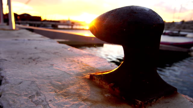 Bollard in the port - Sitges sunset video