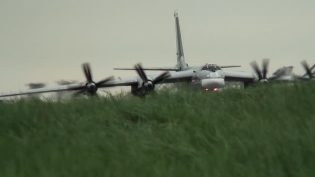 Bomber taxis in the grass video