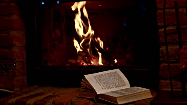 Book by the fireplace Two shots of an open book on a shelf in front of the fireplace. Also available in 4K resolution. fireplace stock videos & royalty-free footage